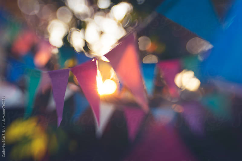 Rows of colourful paper bunting with bokeh... by Catherine MacBride for Stocksy United