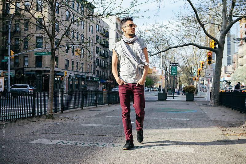 Casual Young Man Walking in New York by Joselito Briones for Stocksy United