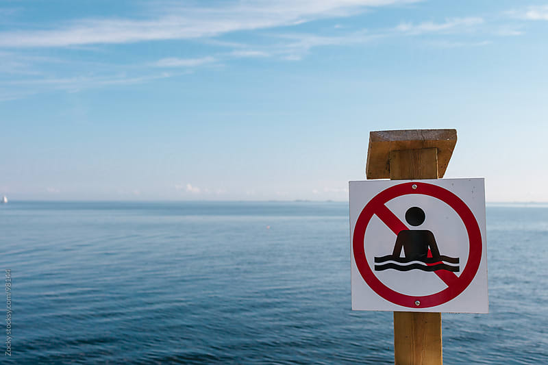 No swimming sign by Zocky for Stocksy United