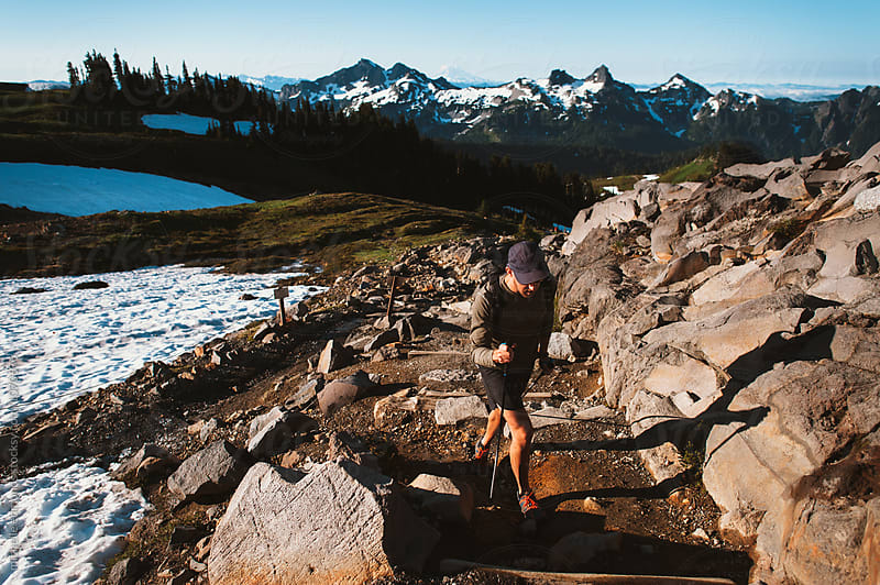 Man Hiking on a Trail in Mount Rainier National Park in Washington by michelle edmonds for Stocksy United