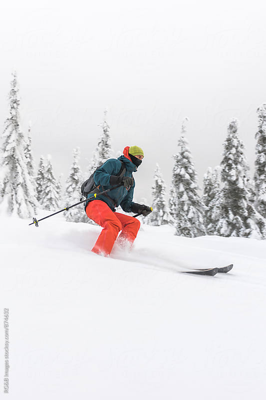 Freeride skier riding in deep snow by RG&B Images for Stocksy United