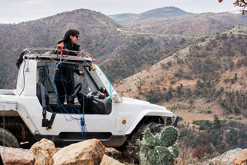 Woman with offroad 4wd car in the mountains by Per Swantesson for Stocksy United