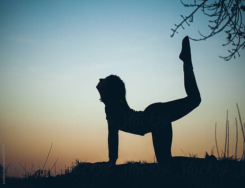 Silhouette of a Woman Doing Yoga Outdoors by Lumina for Stocksy United