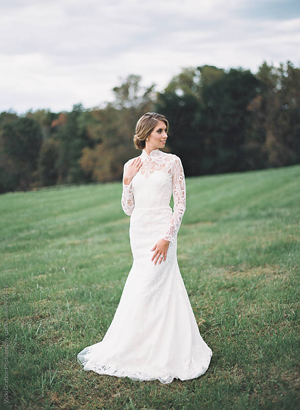Bride in a modern lace wedding dress  by Vicki Grafton Photography for Stocksy United