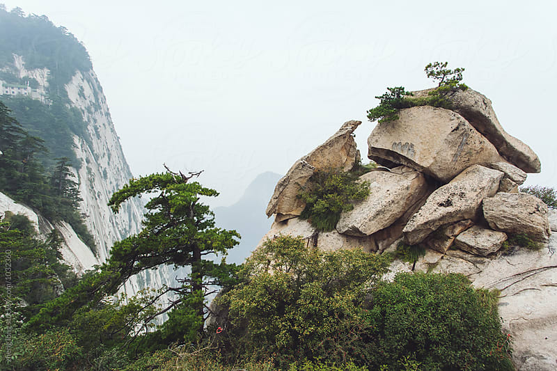 Huashan Mountain in the fog by zheng long for Stocksy United