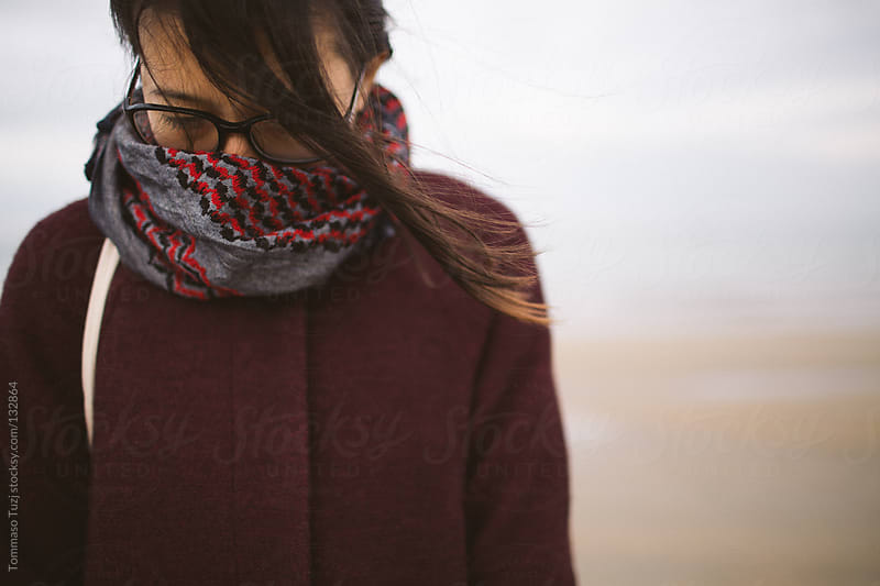 Girl with scarf by Tommaso Tuzj for Stocksy United