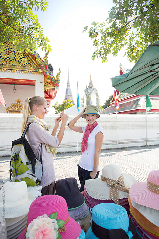 Two Female Tourists, on vacation in Bangkok. Thailand. by Hugh Sitton for Stocksy United