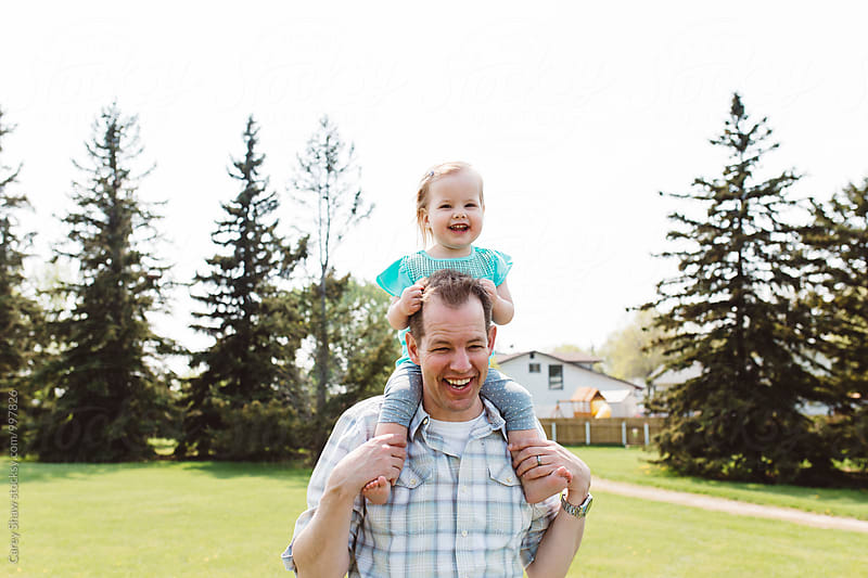Happy young girl having fun and laughing with her dad by Carey Shaw for Stocksy United