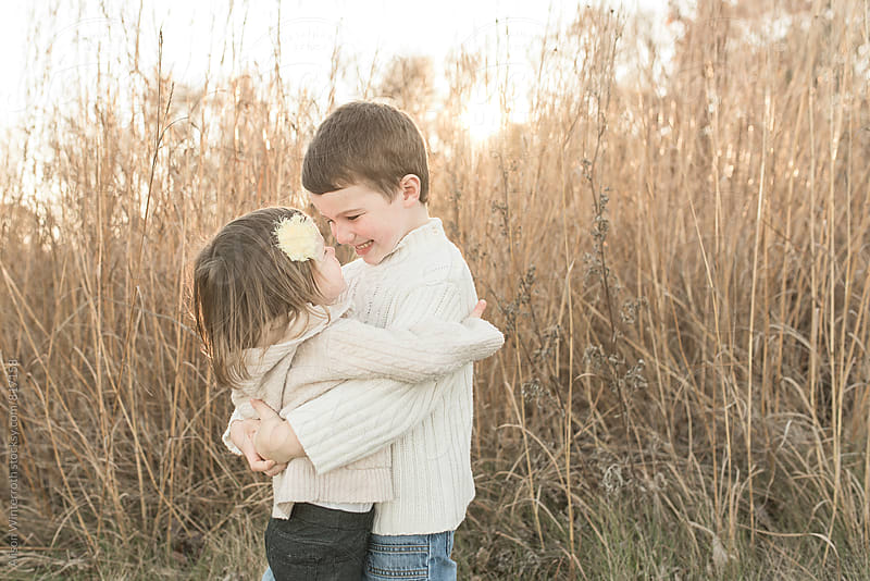 Brother And Sister Hugging by Alison Winterroth for Stocksy United