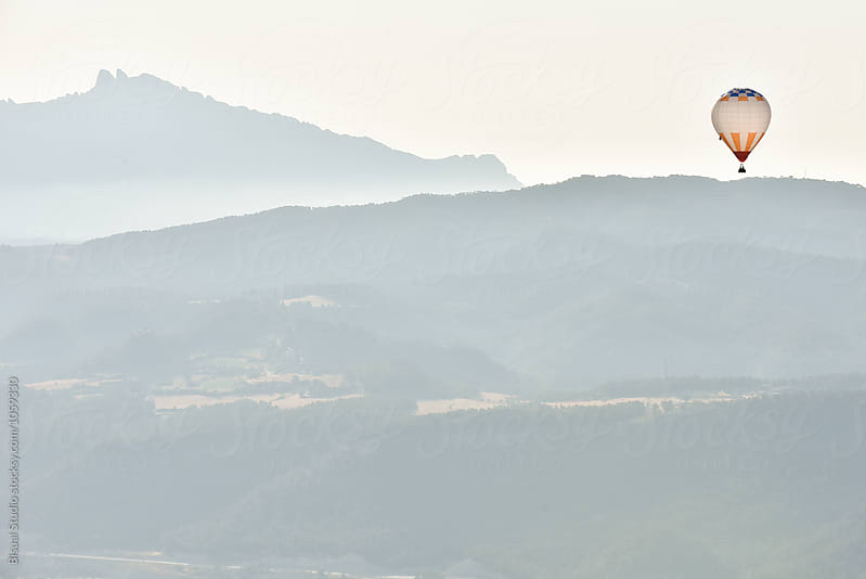 Hot air balloon flying over Igualada, Catalonia, Spain by Bisual Studio for Stocksy United