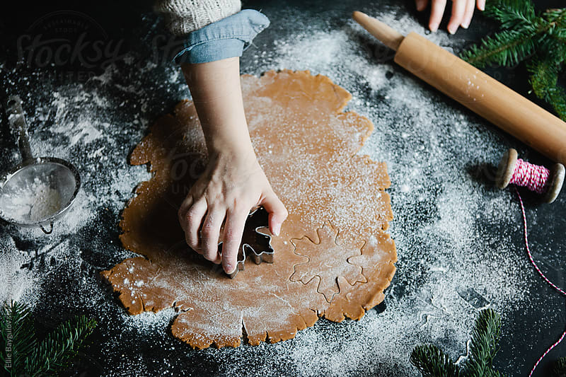 Woman cutting out cookies from dough by Ellie Baygulov for Stocksy United
