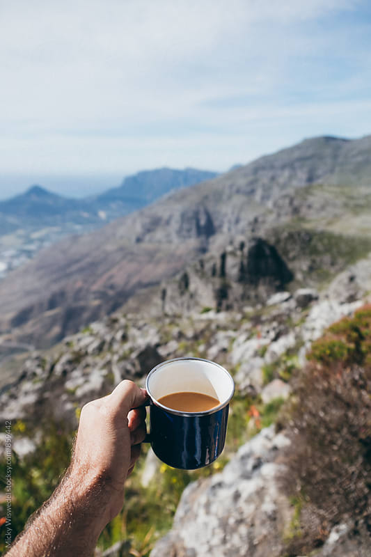 point of view shot of hiker having coffee or tea on a mountain summit by Micky Wiswedel for Stocksy United