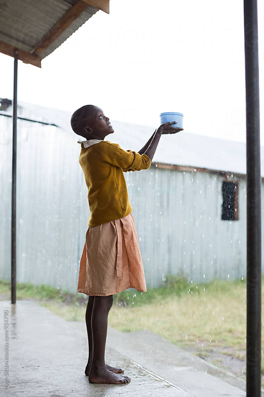School children collecting rain water. Kenya. by Hugh Sitton for Stocksy United