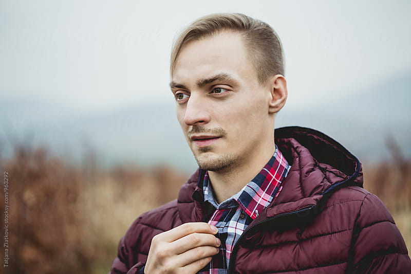Portrait of a young man by Tatjana Ristanic for Stocksy United