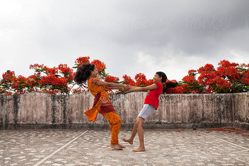 A young woman and a teenage girl making fun by PARTHA PAL for Stocksy United