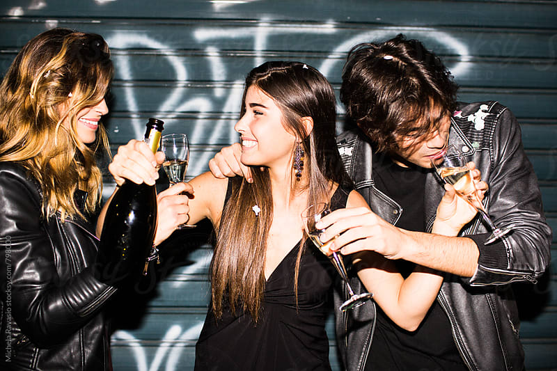 Friends drinking together at a party by michela ravasio for Stocksy United