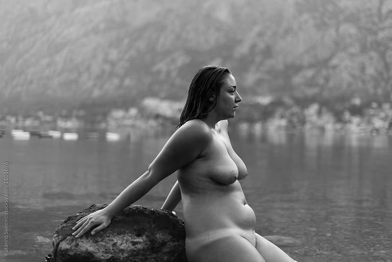 Portrait of naked woman sitting on rock by Kate & Mary for Stocksy United