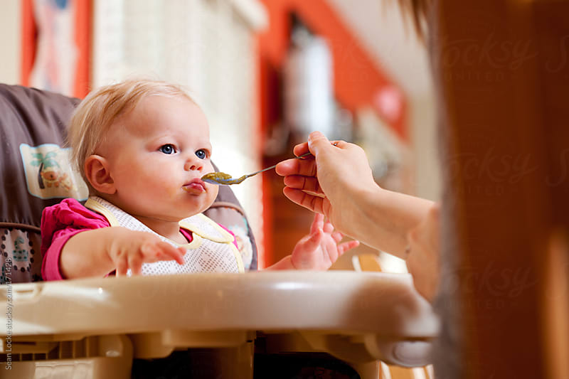 Baby: Infant Ready For Another Spoon Of Food by Sean Locke for Stocksy United