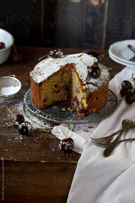 Cherry cake on cooling wrack by Noemi Hauser for Stocksy United