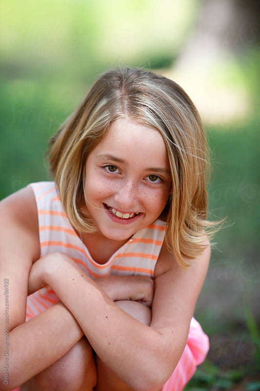 Portrait of happy pre-teen girl by Dina Giangregorio for Stocksy United