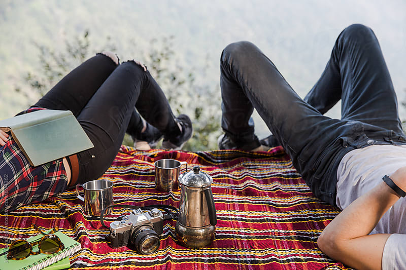 Couple relaxing together at picnic by Jovo Jovanovic for Stocksy United