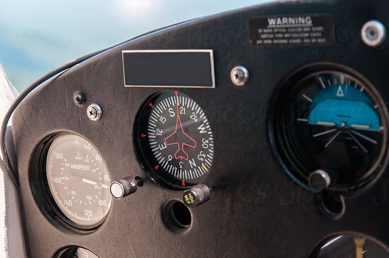Dials and instruments on small airplane control panel by Matthew Spaulding for Stocksy United