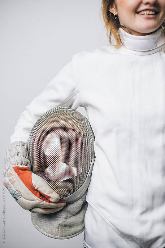 Professional female fencer holding mask by Danil Nevsky for Stocksy United