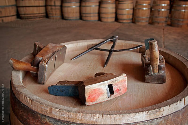 Cooper's tools on barrel head by Ferenc Boros for Stocksy United