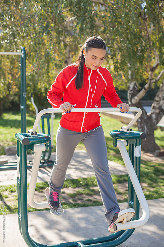 Woman Working Out in the Outdoor Gym by Mosuno for Stocksy United
