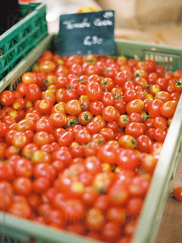Tomatoes at a market in France by Kirstin Mckee for Stocksy United