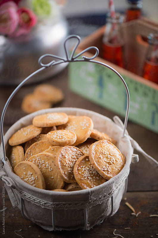 paprika biscuits with salted ricotta cheese as appetizer by Laura Adani for Stocksy United