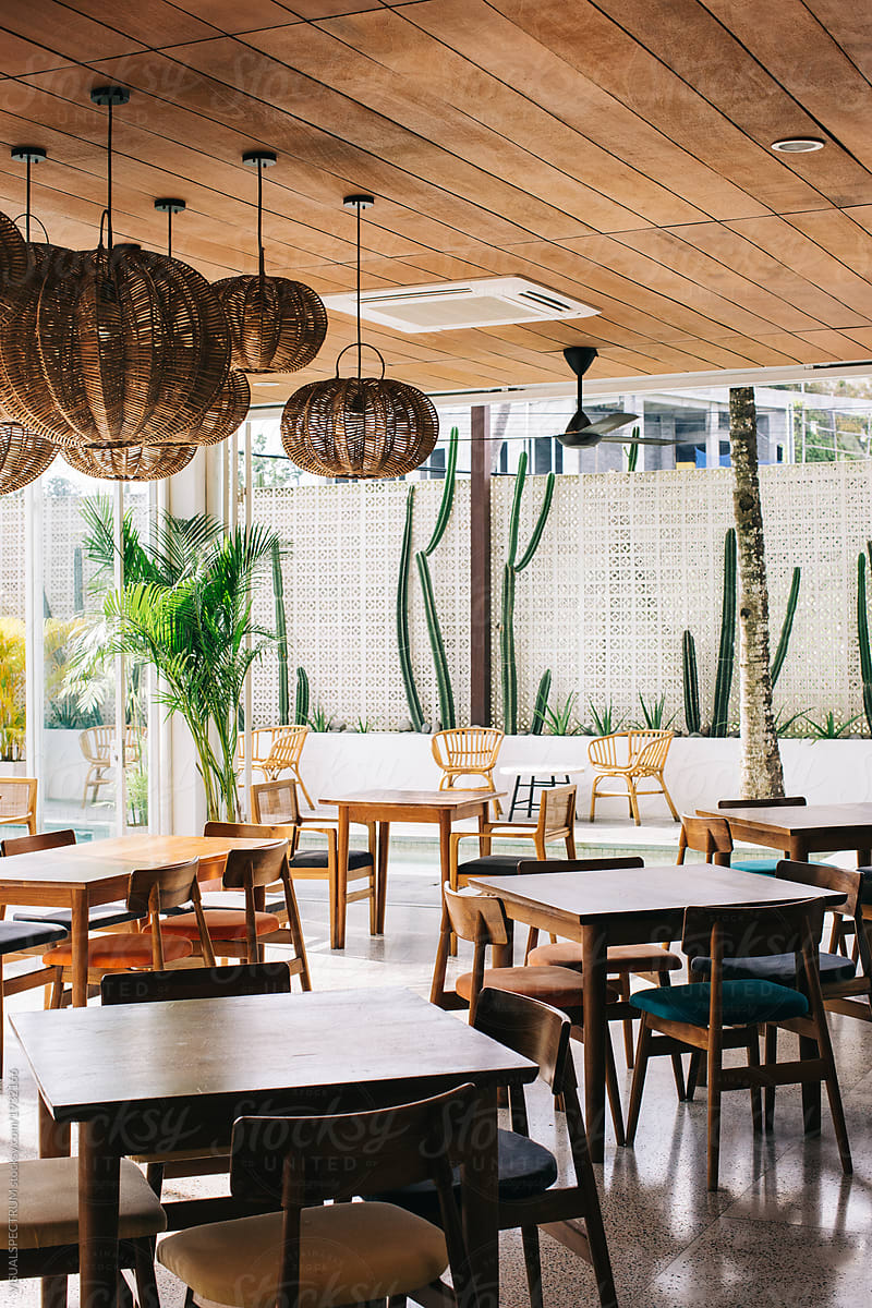 Tropical Interior Design Empty Restaurant In Stylish Beach Club By Visualspectrum Restaurant Cafeteria Stocksy United