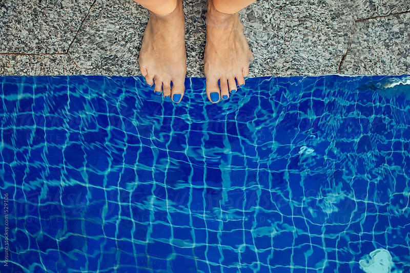 Female Feet at the Edge of the Pool by Mosuno for Stocksy United