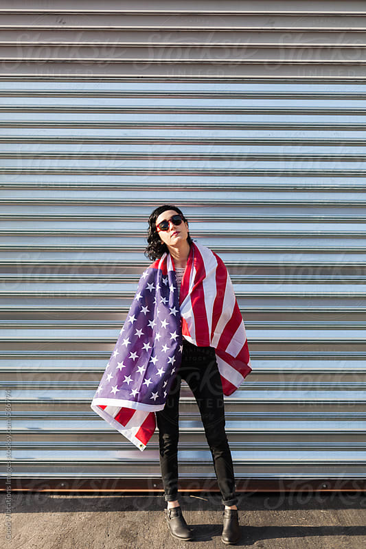 Attractive brunette with the American Flag by Good Vibrations Images for Stocksy United
