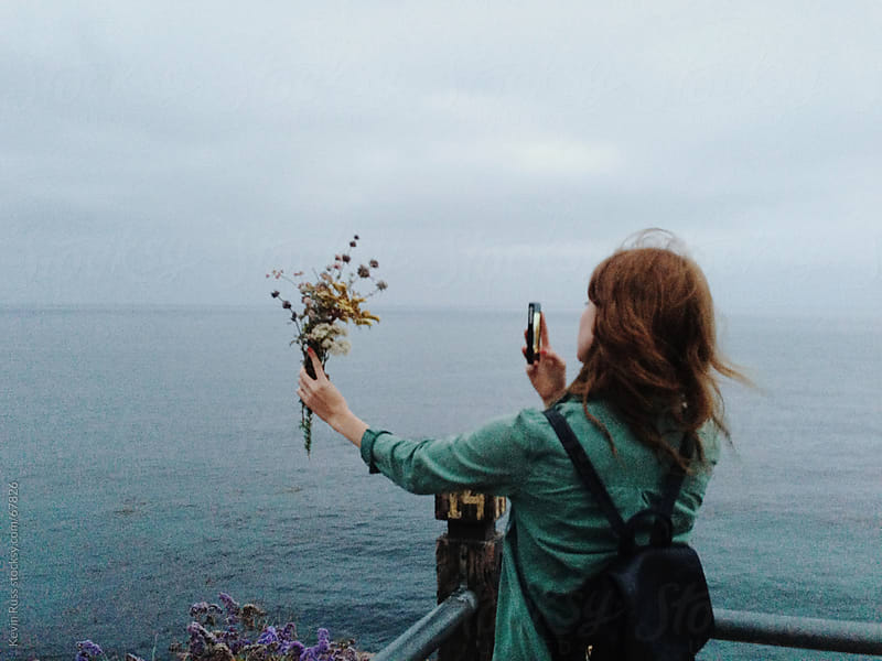 Woman Taking Pictures of Flowers by Kevin Russ for Stocksy United