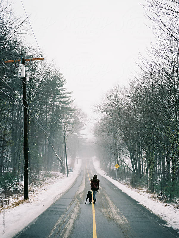 girl walking dog on a doggy day by Léa Jones for Stocksy United