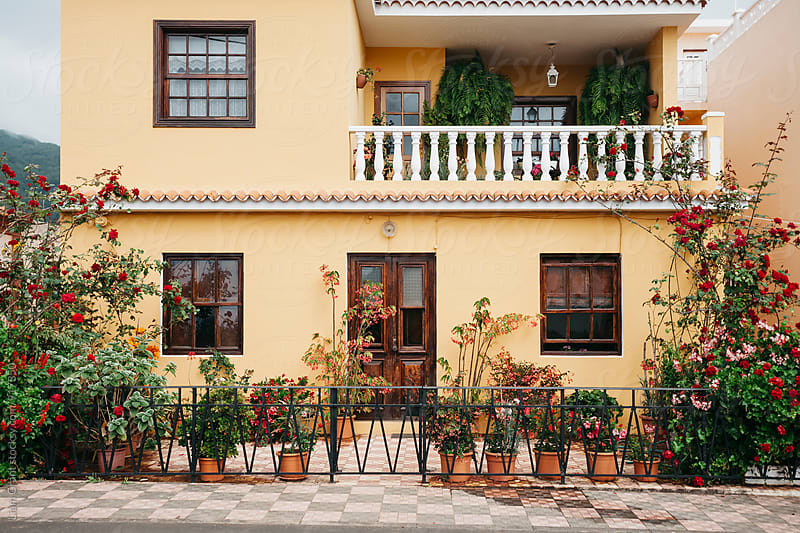 Yellow building with balcony and plants. La Palma, Canary islands. by Liam Grant for Stocksy United