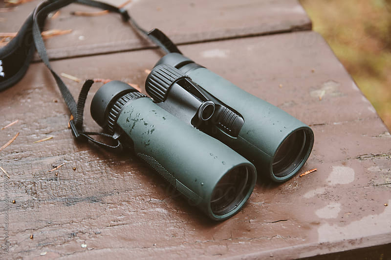 Binoculars laying on a picnic table outside by Justin Mullet for Stocksy United