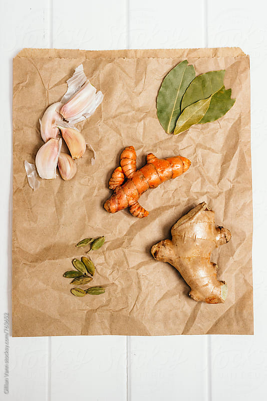 various spices on a paper grocery bag by Gillian Vann for Stocksy United