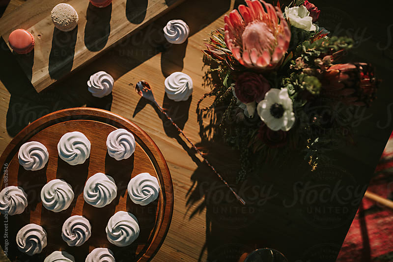 Macaron and Meringue Desserts on a Table by Rachel Gulotta Photography for Stocksy United