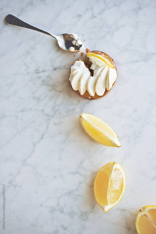 lemon meringue tart by Gillian Vann for Stocksy United