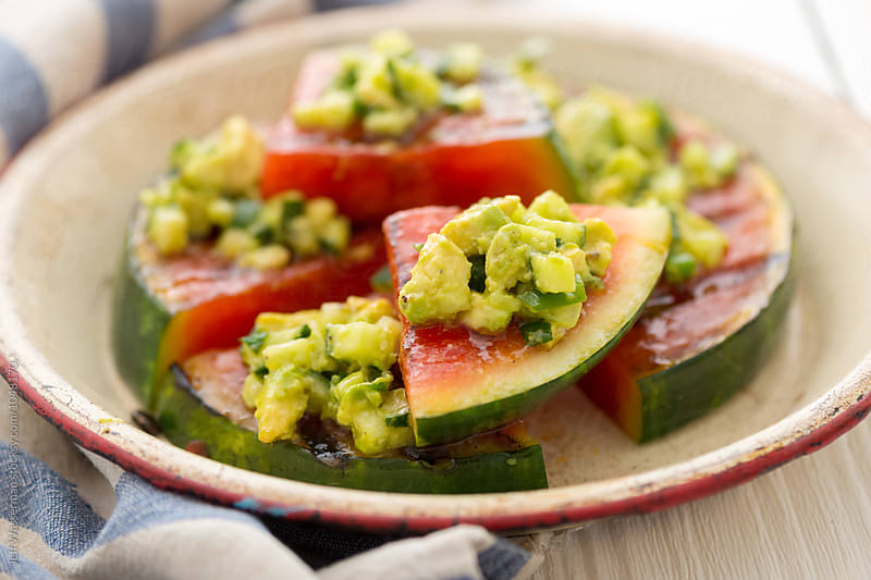 Grilled Watermelon with Avocado, Cucumber, Jalapeno salsa by Studio Six for Stocksy United