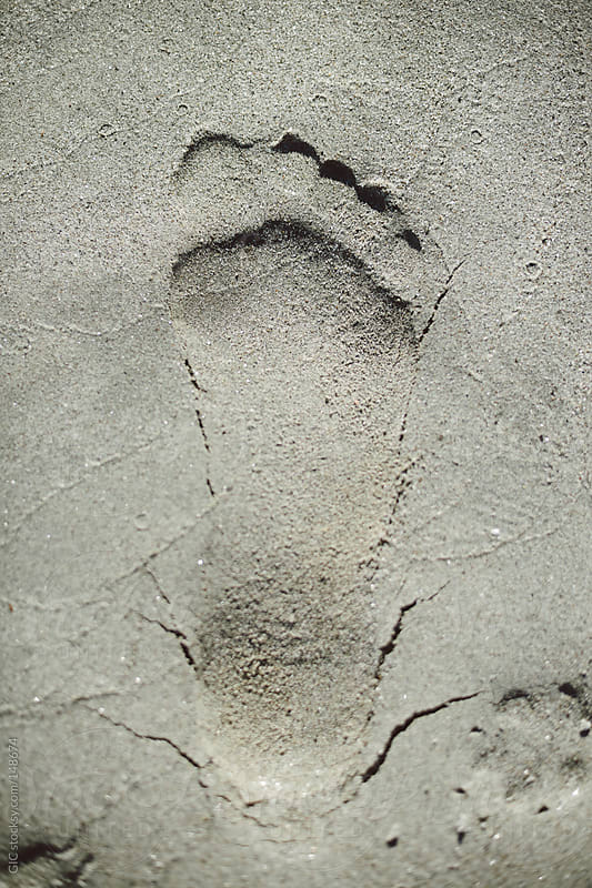 Footprint in the sand by GIC for Stocksy United