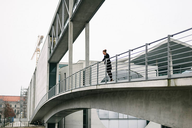 Young businesswoman on a contemporary bridge in Berlin by GIC for Stocksy United