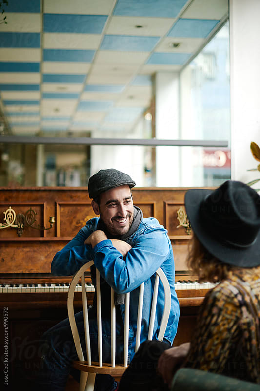 Couple at the cafe by Jose Coello for Stocksy United