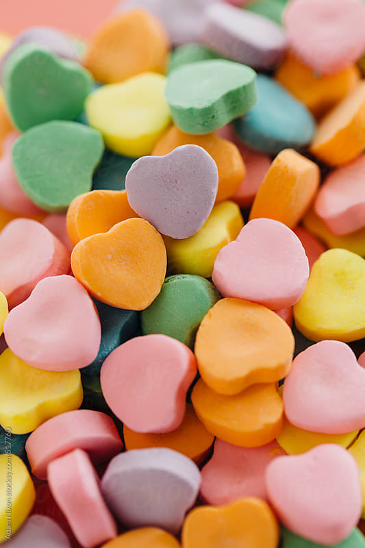 Heart shaped candy in assorted colors by Adam Nixon for Stocksy United