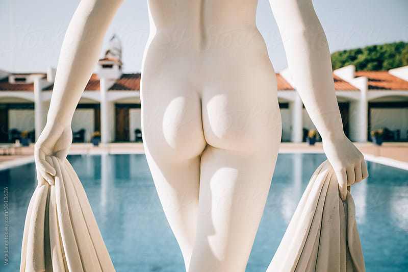 Close-up of sunlit statue nude ass by Vera Lair for Stocksy United