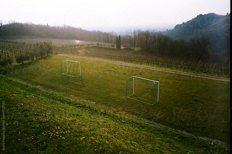A film photo of empty football field by Anna Malgina for Stocksy United