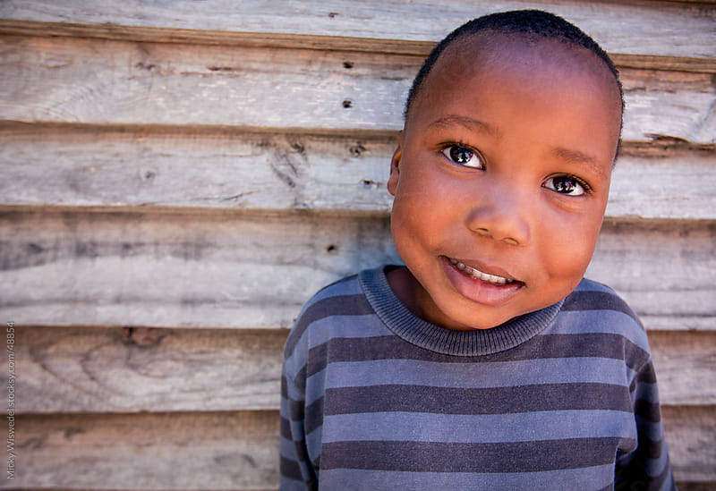 cute African township boy by Micky Wiswedel for Stocksy United