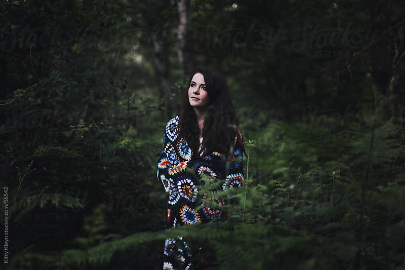 Girl wandering in the woods by Kitty Kleyn for Stocksy United